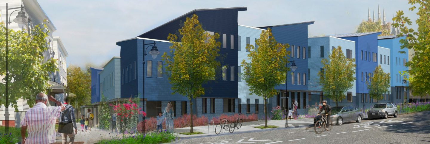 Some new blue, modern housing condos line a beautiful residential street in Lewiston, Maine